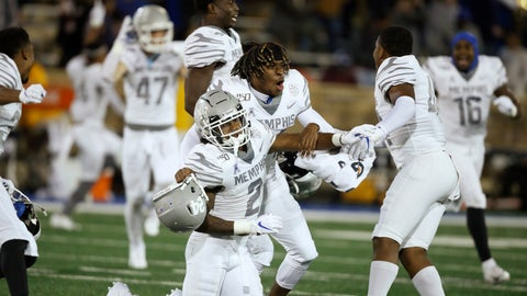 <p>               Memphis players T.J. Carter (2), Cameron Fleming, center, and Kendell Johnson, right, celebrate at the end of the game after defeating Tulsa 42-41 in an NCAA college football game in Tulsa, Okla., Saturday, Oct. 26, 2019. (AP Photo/Sue Ogrocki)             </p>