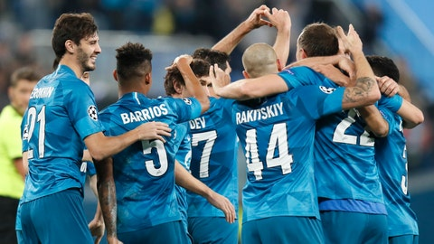 <p>               Zenit players celebrate after Zenit's Magomed Ozdoyev scored his side's second goal during the Champions League group G soccer match between Zenit St. Petersburg and Lyon at the Saint Petersburg stadium in St. Petersburg, Russia, Wednesday, Nov. 27, 2019. (AP Photo/Dmitri Lovetsky)             </p>