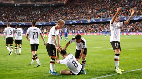 <p>               Valencia's players celebrate after scoring the opening goal during the Champions League group H soccer match between Valencia and Chelsea at the Mestalla stadium in Valencia, Spain, Wednesday, Nov. 27, 2019. (AP Photo/Alberto Saiz)             </p>