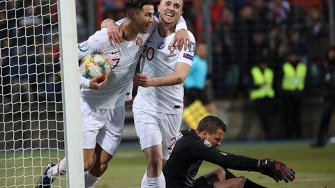 <p>               Portugal's Cristiano Ronaldo, left, celebrates with his teammate Diogo Jota after he scored his side's second goal during the Euro 2020 group B qualifying soccer match between Luxembourg and Portugal at the Josy Barthel stadium in Luxembourg, Sunday, Nov. 17, 2019. (AP Photo/Francisco Seco)             </p>