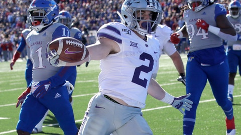 <p>               Kansas State running back Harry Trotter (2) scores a touchdown in front of Kansas safety Mike Lee (11) and defensive end Codey Cole III (94) during the first half of an NCAA college football game in Lawrence, Kan., Saturday, Nov. 2, 2019. (AP Photo/Orlin Wagner)             </p>