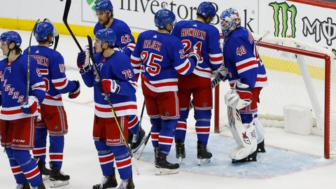 <p>               New York Rangers goaltender Alexandar Georgiev, right, celebrates with teammates after defeating the New Jersey Devils 4-0 during an NHL hockey game Saturday, Nov. 30, 2019, in Newark, N.J. (AP Photo/Noah K. Murray)             </p>