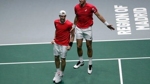 <p>               Canada's Denis Shapovalov, left, and his partner Vasek Pospisil celebrate after winning their Davis Cup semifinal doubles match against Russia's Karen Khachanov and Andrey Rublev, in Madrid, Spain, Saturday, Nov. 23, 2019. (AP Photo/Bernat Armangue)             </p>