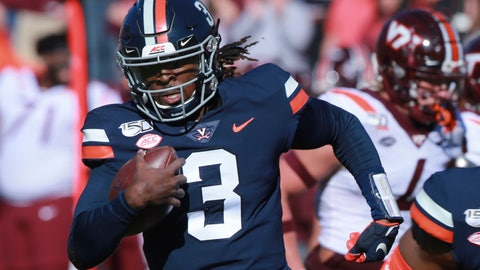 <p>               Virginia quarterback Bryce Perkins (3) heads to the end zone for a touchdown during the first half of an NCAA college football game against Virginia Tech in Charlottesville, Va., Friday, Nov. 29, 2019. (AP Photo/Steve Helber)             </p>