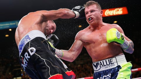 <p>               Canelo Alvarez, left, lands a punch against Sergey Kovalev during a light heavyweight WBO title bout, Saturday, Nov. 2, 2019, in Las Vegas (AP Photo/John Locher)             </p>