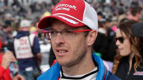 <p>               FILE - In this Jan. 26, 2019, file photo, Sebastian Bourdais, of France, walks down pit road before the IMSA 24-hour race at Daytona International Speedway, in Daytona Beach, Fla. Bourdais parted ways with Dale Coyne Racing on Friday, Nov. 22, 2019, and will move from IndyCar to sports cars in IMSA in 2020. The announcement came after several weeks of negotiations between Coyne and Bourdais, who had a year remaining on his contract but support from engine provider Honda had been pulled for the Frenchman after Bourdais failed to score any manufacturer points in 2019. (AP Photo/John Raoux, File)             </p>