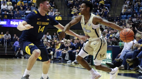 <p>               Akron's Loren Cristian Jackson is defended by West Virginia's Chase Harler during an NCAA college basketball game, Friday, Nov. 8, 2019, in Morgantown, W.Va. (AP Photo/Kathleen Batten)             </p>