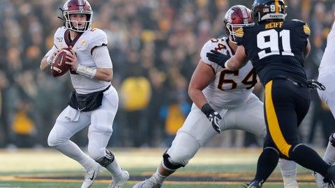 <p>               Minnesota quarterback Tanner Morgan, left, drops back to pass during the first half of an NCAA college football game against Iowa, Saturday, Nov. 16, 2019, in Iowa City, Iowa. (AP Photo/Matthew Putney)             </p>