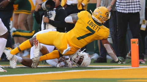 <p>               Baylor running back John Lovett (7) falls backward into the end zone for a touchdown against Texas in an NCAA college football game Saturday, Nov. 23, 2019, in Waco, Texas. (AP Photo/Richard W. Rodriguez)             </p>