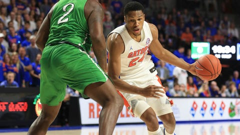 <p>               Florida forward Kerry Blackshear Jr. (24) dribbles around Marshall forward Iran Bennett (2) during the first half of an NCAA college basketball game Friday, Nov. 29, 2019, in Gainesville, Fla. (AP Photo/Matt Stamey)             </p>
