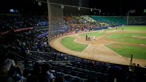 <p>               The stadium is partially empty during the opening winter season game between Los Leones de Caracas and Los Tigres de Aragua in Caracas, Venezuela, Tuesday, Nov. 5, 2019. A deepening crisis has left her nation in shambles, and a recent curve ball from the Trump administration has prevented big league players in the MLB from taking the field, stripping away star-power that fans have come to expect over decades. (AP Photo/Ariana Cubillos)             </p>