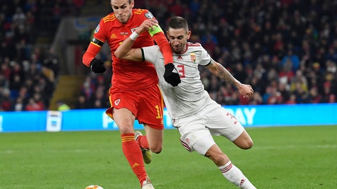 <p>               Zsolt Nagy, right, of Hungary and Gareth Bale of Wales in action during the Euro 2020 group E qualifying soccer match between Wales and Hungary at Cardiff City Stadium in Cardiff, Wales, Tuesday, Nov. 19, 2019. (Tamas Kovacs/MTI via AP)             </p>