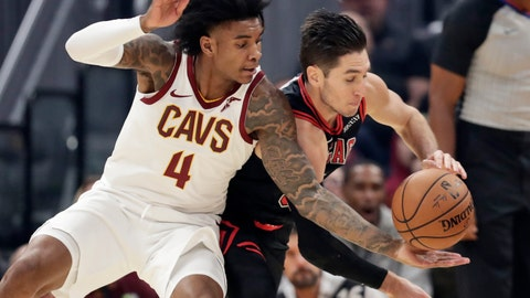 <p>               Cleveland Cavaliers' Kevin Porter Jr. (4) and Chicago Bulls' Ryan Arcidiacono (51) compete for the ball during the first half of an NBA basketball game Wednesday, Oct. 30, 2019, in Cleveland. (AP Photo/Tony Dejak)             </p>