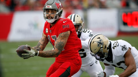 <p>               Tampa Bay Buccaneers wide receiver Mike Evans (13) makes a catch in front of New Orleans Saints cornerback P.J. Williams (26) and free safety Marcus Williams (43) during the second half of an NFL football game Sunday, Nov. 17, 2019, in Tampa, Fla. (AP Photo/Mark LoMoglio)             </p>