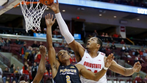 <p>               Ohio State forward Kaleb Wesson, right, blocks a shot by Purdue Fort Wayne guard Brian Patrick (2) as Ohio State guard Luther Muhammad defends during the first half of an NCAA college basketball game in Columbus, Ohio, Friday, Nov. 22, 2019. (AP Photo/Paul Vernon)             </p>