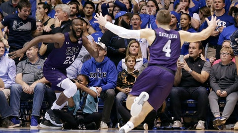 <p>               Stephen F. Austin forward Nathan Bain (23) and guard David Kachelries (4) celebrate Bain's game winning basket against Duke in overtime of an NCAA college basketball game in Durham, N.C., Tuesday, Nov. 26, 2019. (AP Photo/Gerry Broome)             </p>