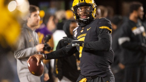<p>               Missouri quarterback Kelly Bryant warms up before an NCAA college football game against Tennessee, Saturday, Nov. 23, 2019, in Columbia, Mo. (AP Photo/L.G. Patterson)             </p>