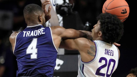 <p>               Kansas State forward Xavier Sneed (20) is fouled by Monmouth forward Mustapha Traore (4) during the first half of an NCAA college basketball game in Manhattan, Kan., Wednesday, Nov. 13, 2019. (AP Photo/Orlin Wagner)             </p>