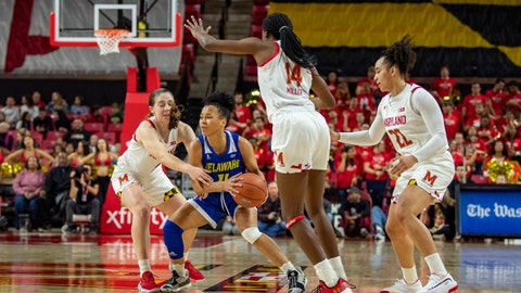 <p>               Delaware guard Paris McBride (4) tries to break away from Maryland guards Blair Watson (22), Diamond Miller (14) and Taylor Mikesell (11) during the first half of an NCAA college basketball game, Sunday, Nov. 17, 2019, in College Park, Md. (AP Photo/Brien Aho)             </p>