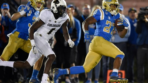 <p>               UCLA running back Joshua Kelley, right, runs for a touchdown past Colorado cornerback Delrick Abrams Jr., center, during the second half of an NCAA college football game as Ethan Fernea follows the play in Los Angeles, Saturday, Nov. 2, 2019. UCLA won 31-14. (AP Photo/Kelvin Kuo)             </p>