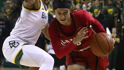 <p>               Lamar guard Amber Vidal (5) drives against Baylor Te'a Cooper in the first half of an NCAA college basketball game, Thursday, Nov. 21, 2019, in Waco, Texas. (AP Photo/Jerry Larson)             </p>