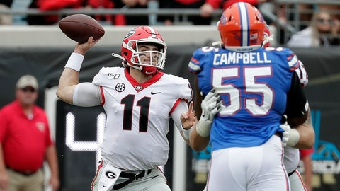 <p>               Georgia quarterback Jake Fromm (11) throws a pass over Florida defensive lineman Kyree Campbell (55) during the first half of an NCAA college football game, Saturday, Nov. 2, 2019, in Jacksonville, Fla. (AP Photo/John Raoux)             </p>