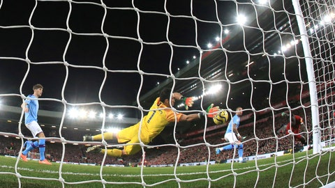 <p>               Liverpool's Sadio Mane, right, heads the ball to score his side's third goal during the English Premier League soccer match between Liverpool and Manchester City at Anfield stadium in Liverpool, England, Sunday, Nov. 10, 2019. (AP Photo/Jon Super)             </p>