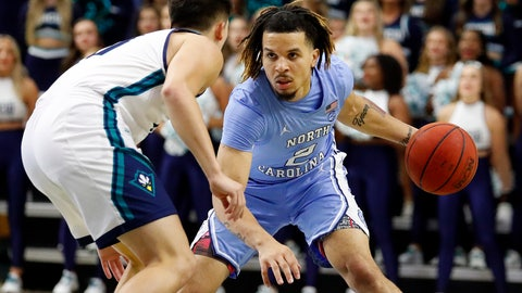 <p>               North Carolina's Cole Anthony (2) brings the ball upcourt against UNC Wilmington 's Kai Toews (10) during the first half of an NCAA college basketball game in Wilmington, N.C., Friday, Nov. 8, 2019. (AP Photo/Karl B DeBlaker)             </p>