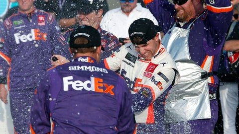 <p>               Denny Hamlin, center, gets sprayed with champagne by pit crew members in Victory Lane after he won the NASCAR Cup Series auto race Sunday, Nov. 10, 2019, in Avondale, Ariz. (AP Photo/Ralph Freso)             </p>