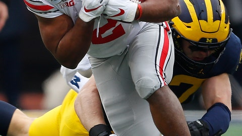 <p>               Ohio State running back J.K. Dobbins (2) escapes the tackle of Michigan defensive lineman Aidan Hutchinson (97) in the first half of an NCAA college football game in Ann Arbor, Mich., Saturday, Nov. 30, 2019. (AP Photo/Paul Sancya)             </p>