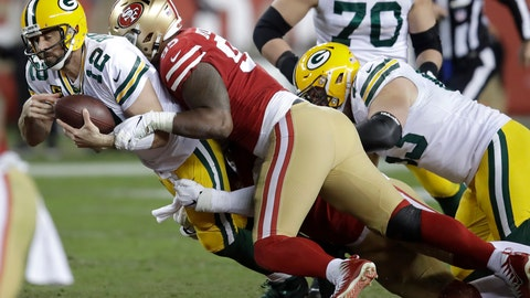 <p>               Green Bay Packers quarterback Aaron Rodgers (12) is sacked by San Francisco 49ers defensive tackle DeForest Buckner, center, and San Francisco 49ers defensive end Arik Armstead, bottom, during the second half of an NFL football game in Santa Clara, Calif., Sunday, Nov. 24, 2019. (AP Photo/Ben Margot)             </p>