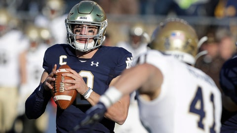 <p>               Notre Dame quarterback Ian Book (12) throws against Navy linebacker Tyler Pistorio (41) during the first half of an NCAA college football game, Saturday, Nov. 16, 2019, in South Bend, Ind. (AP Photo/Darron Cummings)             </p>