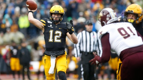 <p>               Appalachian State quarterback Zac Thomas (12) throws to an open receiver while getting pressure from Texas State defensive lineman Jordan Revels (91) during the first half of an NCAA college football game Saturday, Nov. 23, 2019, in Boone, N.C. (AP Photo/Brian Blanco)             </p>