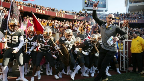 <p>               FILE - In this Oct. 26, 2019, file photo, Minnesota head coach P.J. Fleck leads him team on the field prior to an NCAA college football game against Maryland, in Minneapolis. Penn State (8-0) plays against Minnesota (8-0)  on Saturday, Nov. 9. (AP Photo/Stacy Bengs, File)             </p>