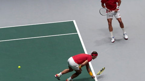 <p>               Spain's Rafael Nadal, front, and his partner Feliciano Lopez return to Great Britain's Jamie Murray and Neal Skupski during their Davis Cup semifinal doubles match, in Madrid, Spain, Saturday, Nov. 23, 2019. (AP Photo/Bernat Armangue)             </p>
