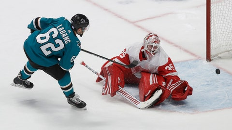 <p>               San Jose Sharks right wing Kevin Labanc (62) scores past Detroit Red Wings goaltender Jimmy Howard in the shootout of an NHL hockey game in San Jose, Calif., Saturday, Nov. 16, 2019. The Sharks won 4-3. (AP Photo/Jeff Chiu)             </p>