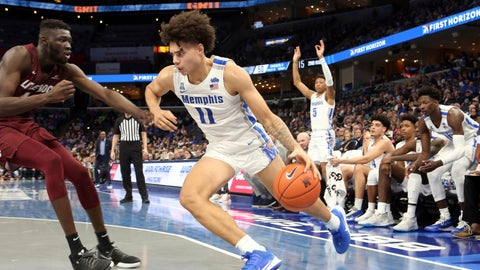<p>               Memphis' Lester Quinones (11) drives the ball past Arkansas-Little Rock's Ruot Monyyong (44) during the second half an NCAA college basketball game Wednesday, Nov. 20, 2019, in Memphis, Tenn. (AP Photo/Karen Pulfer Focht)             </p>