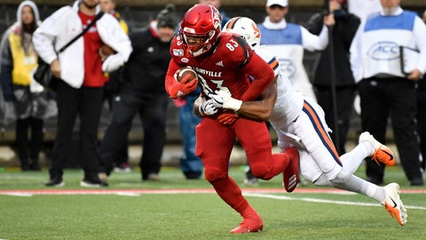 <p>               Louisville tight end Marshon Ford (83) drags Syracuse defensive back Andre Cisco (7) with him as he runs for a touchdown during the first half of an NCAA college football game in Louisville, Ky., Saturday, Nov. 23, 2019. (AP Photo/Timothy D. Easley)             </p>