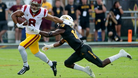 <p>               Southern California wide receiver Amon-Ra St. Brown (8) eludes the tackle of Arizona State safety Cam Phillips (15) during the first half of an NCAA college football game, Saturday, Nov. 9, 2019, in Tempe, Ariz. (AP Photo/Matt York)             </p>