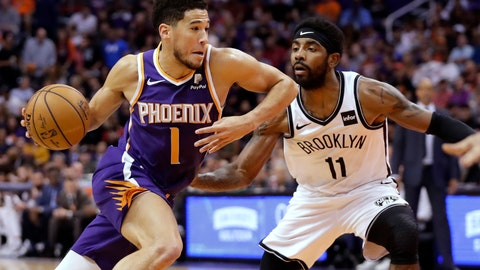 <p>               Phoenix Suns guard Devin Booker (1) drives past Brooklyn Nets guard Kyrie Irving (11) during the first half of an NBA basketball game Sunday, Nov. 10, 2019, in Phoenix. (AP Photo/Matt York)             </p>