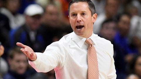 <p>               Florida head coach Mike White calls to an official during the first half of an NCAA college basketball game against Connecticut, Sunday, Nov. 17, 2019, in Storrs, Conn. (AP Photo/Jessica Hill)             </p>