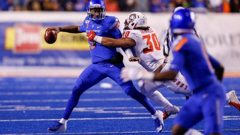 <p>               Boise State quarterback Jaylon Henderson, left, looks to throw the ball as New Mexico linebacker Alexander Vainikolo, right, tries to pull him down during the second half of an NCAA college football game Saturday, Nov. 16, 2019, in Boise, Idaho. Boise State won 42-9.(AP Photo/Steve Conner)             </p>