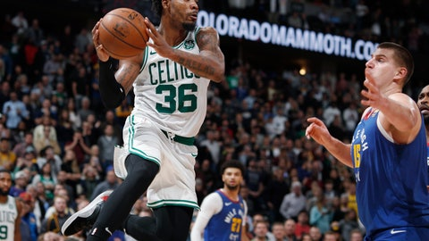 <p>               Boston Celtics guard Marcus Smart pulls in a rebound as Denver Nuggets center Nikola Jokic defends during the second half of an NBA basketball game Friday, Nov. 22, 2019, in Denver. The Nuggets won 96-92. (AP Photo/David Zalubowski)             </p>