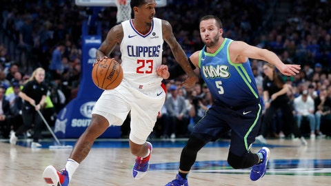 <p>               Los Angeles Clippers guard Lou Williams (23) works against Dallas Mavericks guard J.J. Barea (5) for a shot opportunity in the second half of an NBA basketball game in Dallas, Tuesday, Nov. 26, 2019. (AP Photo/Tony Gutierrez)             </p>