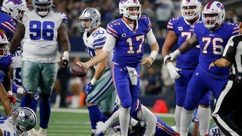 <p>               Buffalo Bills quarterback Josh Allen (17) celebrates after recovering a fumbled snap and getting a first down on the play in the first half of an NFL football game against the Dallas Cowboys in Arlington, Texas, Thursday, Nov. 28, 2019. The Cowboys' Maliek Collins (96) and Bills Jon Feliciano (76) look on during the play. (AP Photo/Michael Ainsworth)             </p>