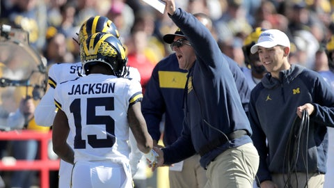 <p>               Michigan head coach Jim Harbaugh, center, congratulates Giles Jackson after he returned the opening kickoff from Maryland for a touchdown during the first half of an NCAA college football game, Saturday, Nov. 2, 2019, in College Park, Md. (AP Photo/Julio Cortez)             </p>