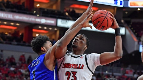 <p>               Louisville center Steven Enoch (23) shoots as Indiana State center Tre Williams (1) defends during the second half of an NCAA college basketball game in Louisville, Ky., Wednesday, Nov. 13, 2019. Louisville won 91-62. (AP Photo/Timothy D. Easley)             </p>