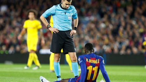<p>               The referee speaks with Barcelona's Ousmane Dembele who had to be substituted after getting injured during a Champions League soccer match Group F between Barcelona and Dortmund at the Camp Nou stadium in Barcelona, Spain, Wednesday, Nov. 27, 2019. (AP Photo/Joan Monfort)             </p>