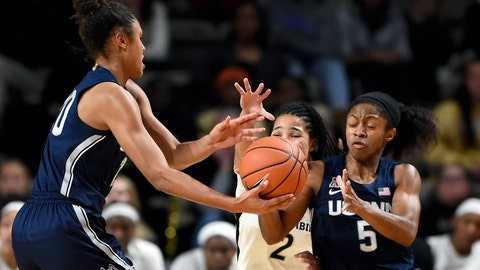 <p>               Connecticut forward Olivia Nelson-Ododa, left, hands the ball to guard Crystal Dangerfield (5) during the first half of an NCAA college basketball game against Vanderbilt Wednesday, Nov. 13, 2019, in Nashville, Tenn. (AP Photo/Mark Zaleski)             </p>