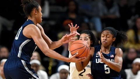 <p>               Connecticut forward Olivia Nelson-Ododa, left, hands the ball to guard Crystal Dangerfield (5) during the first half of an NCAA college basketball game against Vanderbilt Wednesday, Nov. 13, 2019, in Nashville, Tenn. (AP Photo/Mark Zaleski)             </p>